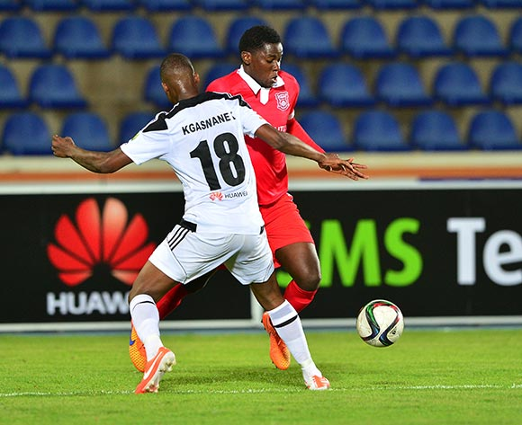 Benson Shilongo of Gaborone United tackled by Kaelo Kgaswane of Mochudi Chiefs during the 2015/16 beMobile Premiership football match between Mochudi Chiefs and Gaborone United at the National Stadium in Gaborone on 12 September 2015 ©Gavin Barker/BackpagePix