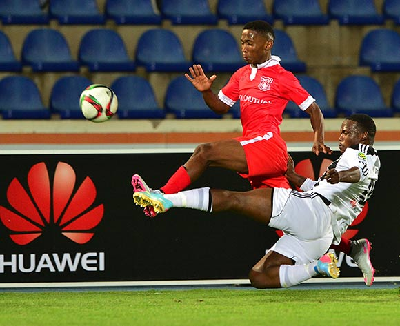 Mpho Kgaswane of Gaborone United tackled by Ontse Ntesa of Mochudi Chiefs during the 2015/16 beMobile Premiership football match between Mochudi Chiefs and Gaborone United at the National Stadium in Gaborone on 12 September 2015 ©Gavin Barker/BackpagePix