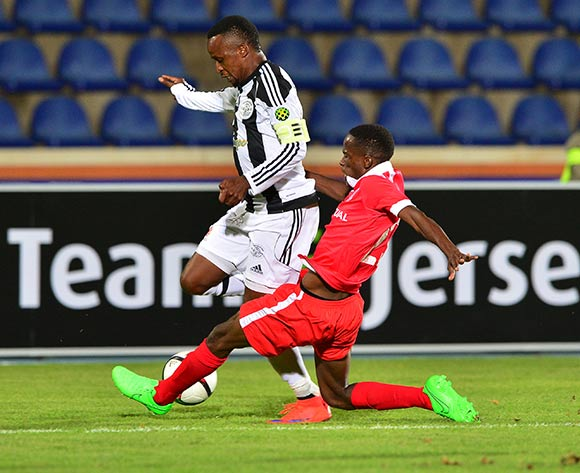 Pontsho Moloi of Mochudi Chiefs tackled by Katlego Koobake of Gaborone United during the 2015/16 beMobile Premiership football match between Mochudi Chiefs and Gaborone United at the National Stadium in Gaborone on 12 September 2015 ©Gavin Barker/BackpagePix