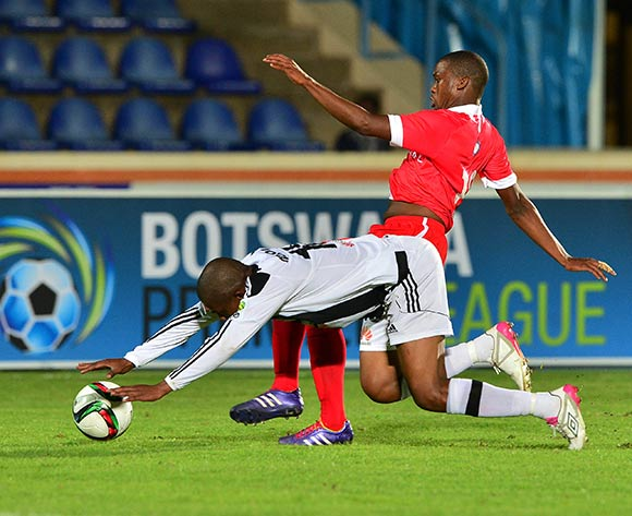 Osego Gaotewe of Gaborone United tackles Kekaetswe Moloi of Mochudi Chiefs during the 2015/16 beMobile Premiership football match between Mochudi Chiefs and Gaborone United at the National Stadium in Gaborone on 12 September 2015 ©Gavin Barker/BackpagePix