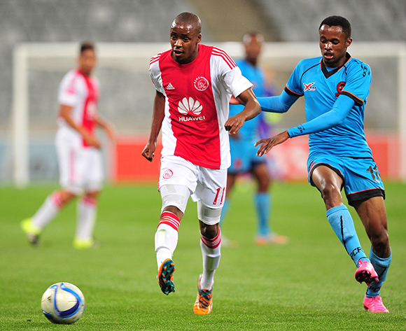 Bantu Mzwakali of Ajax Cape Town passes with the outside of his foot as Jorry Matjila of Polokwane City closes him down during the Absa Premiership 2015/16 game between Ajax Cape Town and Polokwane City at Cape Town Stadium, Cape Town on 12 September 2015 ©Ryan Wilkisky/BackpagePix