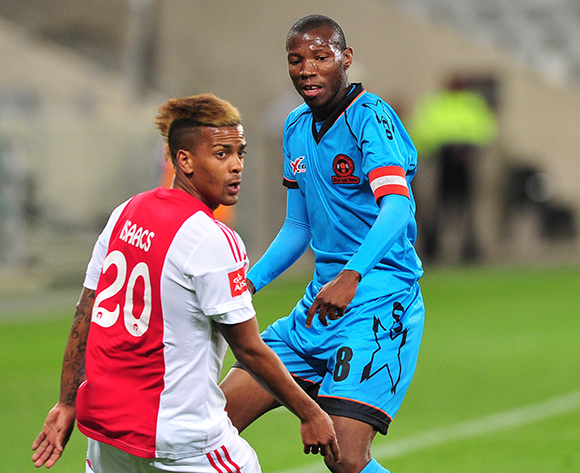 Jabulani Maluleke of Polokwane City knocks the ball past Erwin Isaacs of Ajax Cape Town during the Absa Premiership 2015/16 game between Ajax Cape Town and Polokwane City at Cape Town Stadium, Cape Town on 12 September 2015 ©Ryan Wilkisky/BackpagePix
