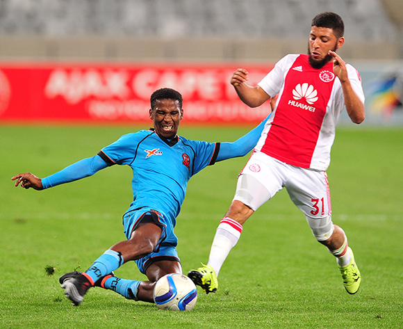Riyaad Norodien of Ajax Cape Town is tackled by Mfundo Phungwayo of Polokwane City during the Absa Premiership 2015/16 game between Ajax Cape Town and Polokwane City at Cape Town Stadium, Cape Town on 12 September 2015 ©Ryan Wilkisky/BackpagePix