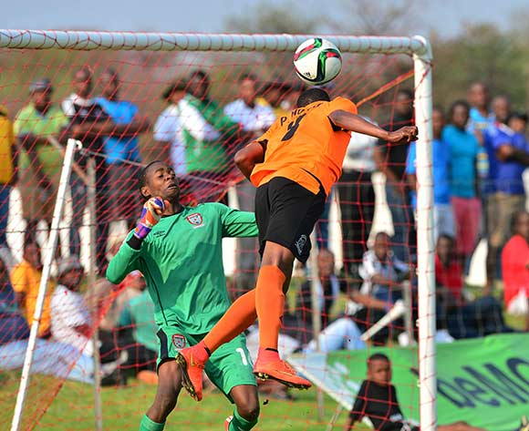 Patrick Motsepe of Orapa heads ball past Ezekiel Morake of Galaxy during the 2015/16 beMobile Premiership football match between Galaxy and Orapa United at the Jwaneng Stadium, in Jwaneng, Botswana on 13  September 2015 ©Gavin Barker/BackpagePix