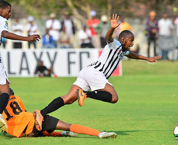 Lemogang Maswena of Orapa fouls Tebogo Sosome of Galaxy during the 2015/16 beMobile Premiership football match between Galaxy and Orapa United at the Jwaneng Stadium, in Jwaneng, Botswana on 13  September 2015 ©Gavin Barker/BackpagePix