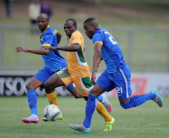 Rodney Ramagalela of Golden Arrows challenged by Siyanda Zwane of Mamelodi Sundowns during the Absa Premiership 2015/16 match between Golden Arrows and Mamelodi Sundowns at Chatsworth Stadium, Chatsworth on the 12 September 2015 ©Muzi Ntombela/BackpagePix