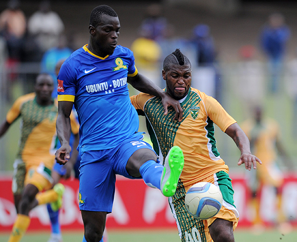 Soumahoro Bangaly of Mamelodi Sundowns battles with Mabhudi Khenyeza of Golden Arrows during the Absa Premiership 2015/16 match between Golden Arrows and Mamelodi Sundowns at Chatsworth Stadium, Chatsworth on the 12 September 2015
