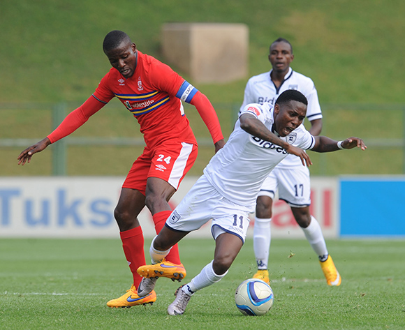 Elias Pelembe of Bidvest Wits is tackled by Ronald Ketjijere of University of Pretoria  during the Absa Premiership match between University of Pretoria and Bidvest Wits  on 13 September 2015 at Tuks Stadium Pic Sydney Mahlangu/ BackpagePix