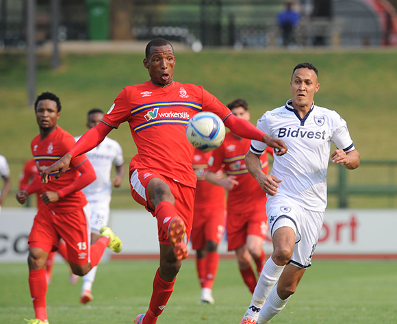 Khaya Gwala of University of Pretoria clears the ball ahead of Henrico Botes  of Bidvest Wits during the Absa Premiership match between University of Pretoria and Bidvest Wits  on 13 September 2015 at Tuks Stadium Pic Sydney Mahlangu/ BackpagePix