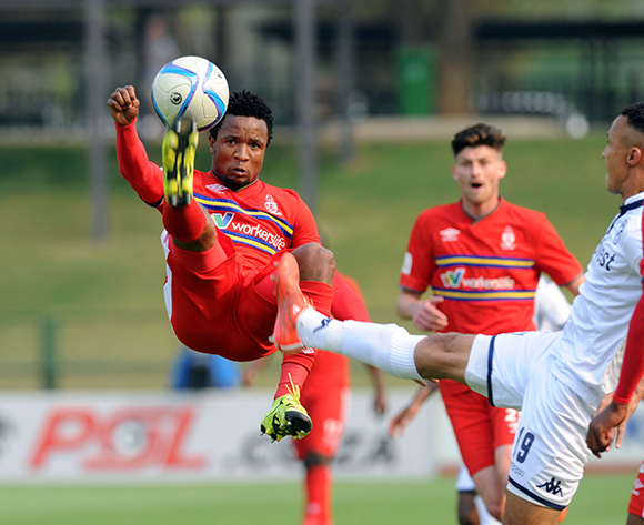 Partson Jaure of University of Pretoria clears the ball ahead of Henrico Botes  of Bidvest Wits during the Absa Premiership match between University of Pretoria and Bidvest Wits  on 13 September 2015 at Tuks Stadium Pic Sydney Mahlangu/ BackpagePix