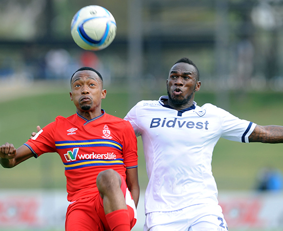Thabo Mnyamane of University of Pretoria challenges Onismor Bhasera of Bidvest Wits during the Absa Premiership match between University of Pretoria and Bidvest Wits  on 13 September 2015 at Tuks Stadium Pic Sydney Mahlangu/ BackpagePix