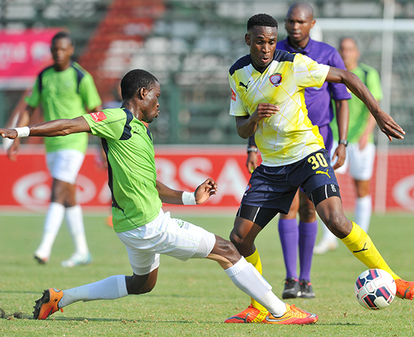 Mxolisi Macuphu of Jomo Cosmos challenged by Robert Ngambi of Platinum Stars during the Absa Premiership match between Jomo Cosmos and Platinum Stars at Olen Park in Potchefstroom, South Africa on September 13, 2015 ©Samuel Shivambu/BackpagePix