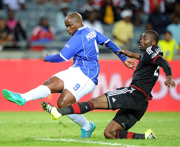 Collins Mbesuma of Black Aces is challenged by Rooi Mahamutsa of Orlando Pirates during the Absa Premiership match between Orlando Pirates and Black Aces  on 18 September 2015 at Orlando Stadium Pic Sydney Mahlangu/ BackpagePix