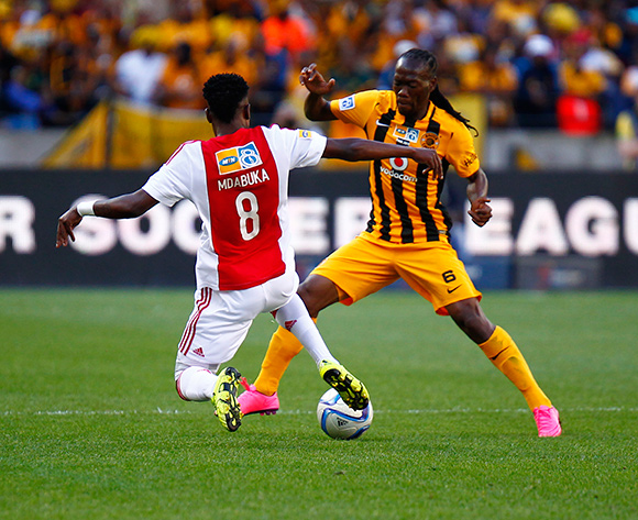 Ndiviwe Mdabuka of Ajax Cape Town tries to tackle Reneilwe Letsholonyane of Kaizer Chiefs  (R) during the 2015 MTN 8 Final football match between Ajax Cape Town and Kaizer Chiefs at Nelson Mandela Bay Stadium, Port Elizabeth, 19 September 2015  ©Michael Sheehan/BackpagePix