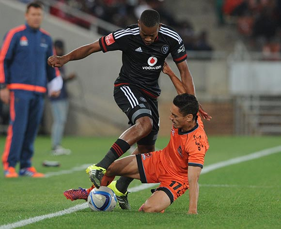 Happy Jele of Orlando Pirates is tackled  by Cole Alexander of Polokwane City during the Absa Premiership match between Polokwane City and Orlando Pirates on 22 September 2015 at Peter Mokaba Stadium Pic Sydney Mahlangu/ BackpagePix