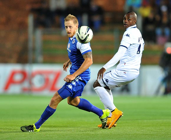 Michael Morton of Supersport United challenged by Papy Faty of Bidvest Wits during the Absa Premiership match between Bidvest Wits and Supersport United at the Bidvest Stadium in Johannesburg, South Africa on September 22, 2015 ©Samuel Shivambu/BackpagePix