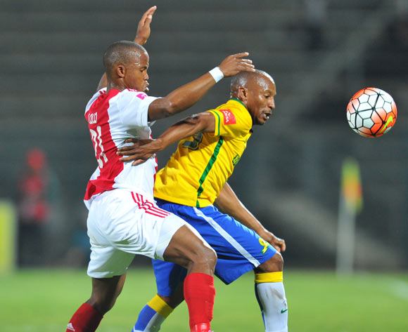Katlego Mashego of Mamelodi Sundowns challenged by Cecil Lolo of Ajax Cape Town during the Absa Premiership match between Mamelodi Sundowns and Ajax Cape Town at the Lucas Moripe Stadium in Pretoria, South Africa on September 23, 2015 ©Samuel Shivambu/BackpagePix