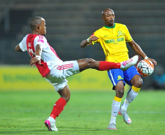 Tebogo Langerman of Mamelodi Sundowns challenged by Cecil Lolo of Ajax Cape Town during the Absa Premiership match between Mamelodi Sundowns and Ajax Cape Town at the Lucas Moripe Stadium in Pretoria, South Africa on September 23, 2015 ©Samuel Shivambu/BackpagePix