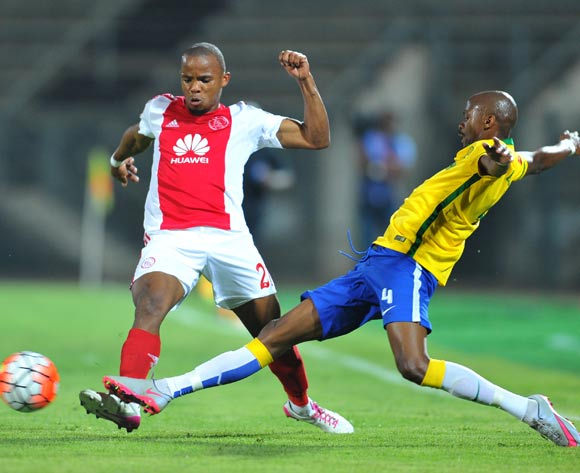 Cecil Lolo of Ajax Cape Town tackled by Tebogo Langerman of Mamelodi Sundowns during the Absa Premiership match between Mamelodi Sundowns and Ajax Cape Town at the Lucas Moripe Stadium in Pretoria, South Africa on September 23, 2015 ©Samuel Shivambu/BackpagePix