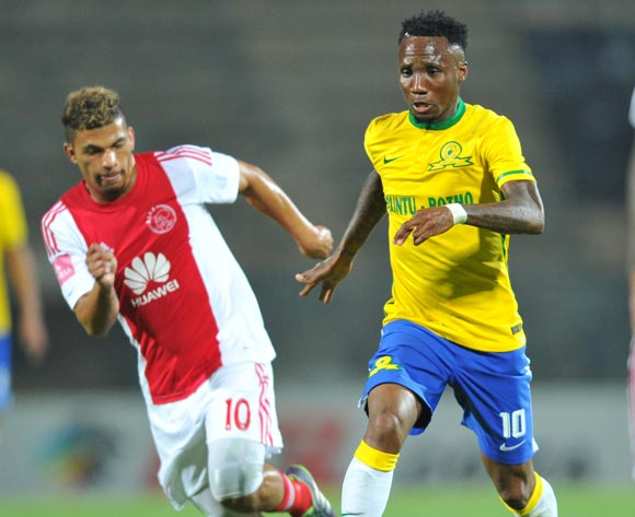 Teko Modise challenged by Toriq Losper of Ajax Cape Town during the Absa Premiership match between Mamelodi Sundowns and Ajax Cape Town at the Lucas Moripe Stadium in Pretoria, South Africa on September 23, 2015 ©Samuel Shivambu/BackpagePix