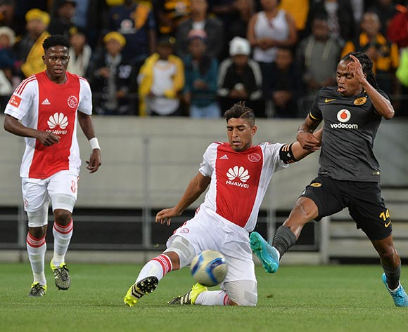 Travis Graham of Ajax Cape Town tackles Siphiwe Tshabalala of Kaizer Chiefs during the Absa Premiership 2015/16 football match between Ajax Cape Town and Kaizer Chiefs at Cape Town Stadium, Cape Town, 26 September 2015  ©Chris Ricco/BackpagePix