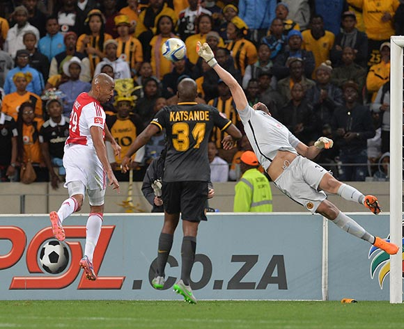Reyaad Pieterse of Kaizer Chiefs touches the ball past the advancing Nathan Paulse of Ajax Cape Town during the Absa Premiership 2015/16 football match between Ajax Cape Town and Kaizer Chiefs at Cape Town Stadium, Cape Town, 26 September 2015  ©Chris Ricco/BackpagePix