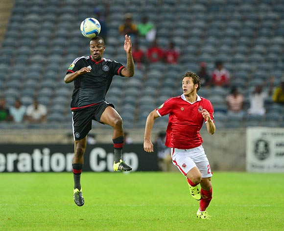 Ntsikelelo Nyauza of Orlando Pirates wins header against Ramadan Sobhi Ahmed of Al Ahly during the 2015 CAF Confederation Cup semifinal, first leg football match between Orlando Pirates and Al Ahly of Egypt at Orlando Stadium in Johannesburg, South Africa on 26 September, 2015 ©Gavin Barker/BackpagePix