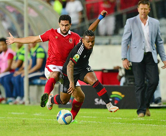 Kermit Erasmus of Orlando Pirates evades tackle from Ahmed Fathi of Al Ahly  during the 2015 CAF Confederation Cup semifinal, first leg football match between Orlando Pirates and Al Ahly of Egypt at Orlando Stadium in Johannesburg, South Africa on 26 September, 2015 ©Gavin Barker/BackpagePix