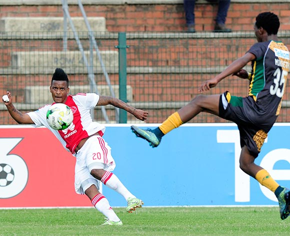 Koloko Mokhethi of Golden Arrows tries to cut off the kick of Erwin Isaacs of Ajax Cape Town during the Telkom Knockout Challenge match between Golden Arrows and Ajax Cape Town at the King Zwelithini Stadium in Umlazi, South Africa on October 03, 2015 ©Gerhard Duraan/BackpagePix