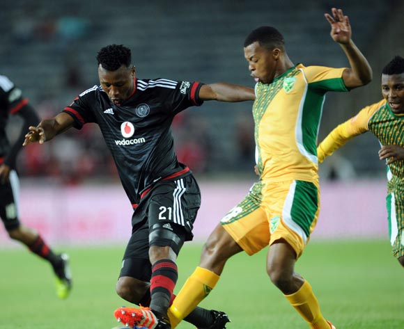 Thembela Sikhakhane of Golden Arrows is tackled by Siyabonga Sangweni of Orlando Pirates during the Absa Premiership match between Orlando Pirates and Golden Arrows  on 28 October 2015 at Orlando Stadium  Pic Sydney Mahlangu/ BackpagePix