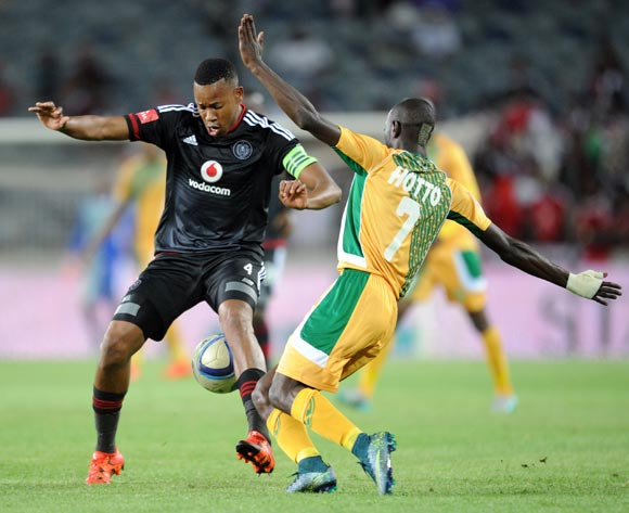 Deon Hotto of Golden Arrows challenges Happy Jele of Orlando Pirates during the Absa Premiership match between Orlando Pirates and Golden Arrows  on 28 October 2015 at Orlando Stadium  Pic Sydney Mahlangu/ BackpagePix