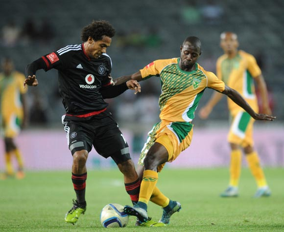 Deon Hotto of Golden Arrows challenges Issa Sarr of Orlando Pirates during the Absa Premiership match between Orlando Pirates and Golden Arrows  on 28 October 2015 at Orlando Stadium  Pic Sydney Mahlangu/ BackpagePix