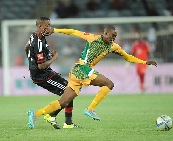 Nkanyiso Cele of Golden Arrows challenges Thamsanqa Gabuza of Orlando Pirates during the Absa Premiership match between Orlando Pirates and Golden Arrows  on 28 October 2015 at Orlando Stadium  Pic Sydney Mahlangu/ BackpagePix