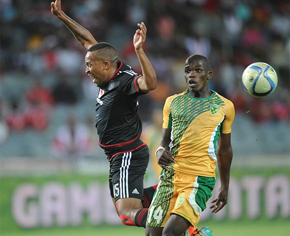 Siyabonga Dube of Golden Arrows challenges Lehlohonolo Majoro  of Orlando Pirates during the Absa Premiership match between Orlando Pirates and Golden Arrows  on 28 October 2015 at Orlando Stadium  Pic Sydney Mahlangu/ BackpagePix