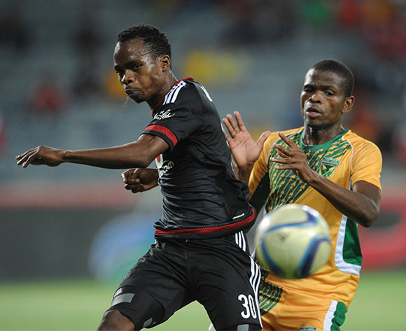 Mpho Mvelase of Orlando Pirates is challenged by Nkanyiso Mngwengwe of Golden Arrows  during the Absa Premiership match between Orlando Pirates and Golden Arrows  on 28 October 2015 at Orlando Stadium  Pic Sydney Mahlangu/ BackpagePix