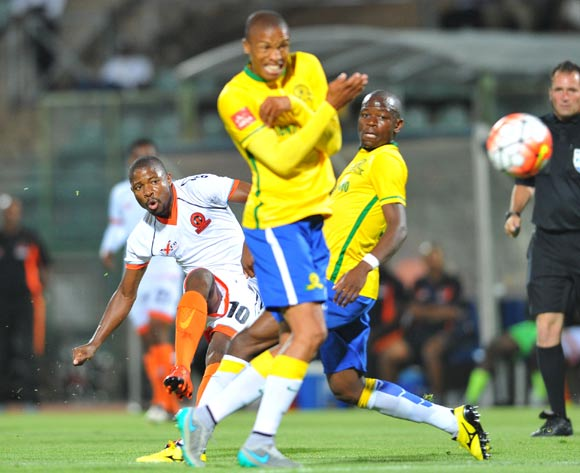 Puleng Tlolane of Polokwane City challenged by Hlompho Kekana of Mamelodi Sundowns during the Absa Premiership match between Mamelodi Sundowns and Polokwane City at the Lucas Moripe Stadium in Pretoria, South Africa on October 28, 2015 ©Samuel Shivambu/BackpagePix