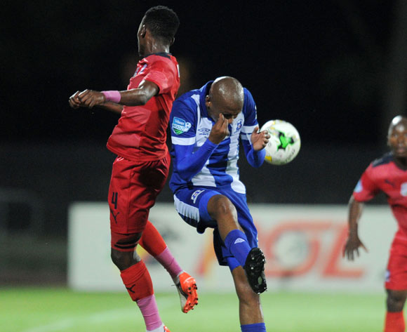 Thabang Monare of Jomo Cosmos battles with Ashley Hartog of Maritzburg United during the 2015 Telkom Knockout match between Maritzburg United and Jomo Cosmos at Harry Gwala Stadium, Pietermaritzburg on the 02 October 2015 ©Muzi Ntombela/BackpagePix
