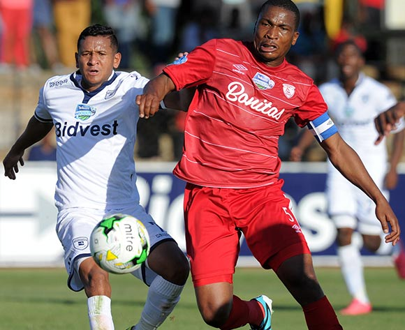 Daine Klate of Bidvest Wits battles with Paulus Masehe of Free State Stars during the 2015 Telkom Knockout match between Free State Stars and Bidvest Wits at Goble Park Stadium, Bethlehem on the 03 October 2015