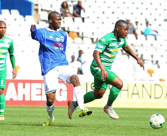 Helder Pelembe of Bloemfontein Celtic challenged by Mpho Matsi of Black Aces during the 2015 Telkom Knockout match between Bloemfontein Celtic and Black Aces at the Free State Stadium in Free State, South Africa on October 04, 2015 ©Samuel Shivambu/BackpagePix