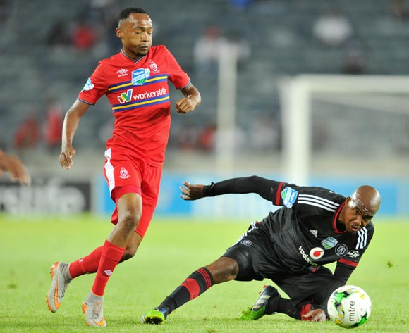 Lehlohonolo Masalesa of Orlando Pirates challenged by Thabo Mnyamane of University Pretoria during the 2015 Telkom Knockout match between Orlando Pirates and University of Pretoria at the Orlando Stadium in Johannesburg, South Africa on October 16, 2015 ©Samuel Shivambu/BackpagePix