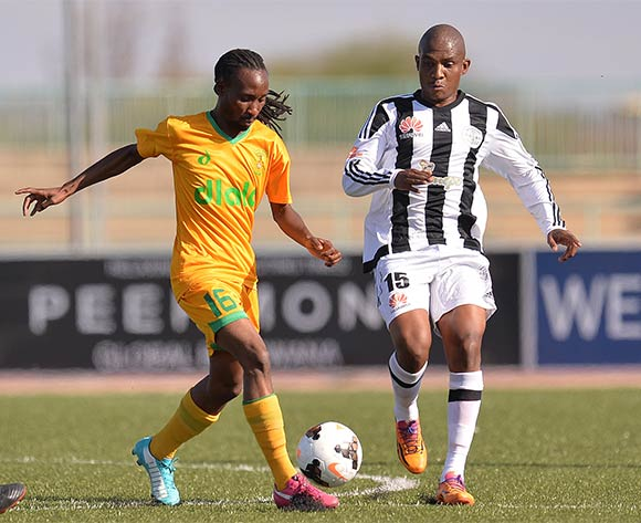Pako Ross Botshelo of Green Lovers Footballclub and Kekaetswe Moloi of Mochudi Centre Chiefs during the beMobile premiership match between Mochudi centre Chief and Green Lovers football Club at the Molepolole sports complex in Molepolole, Botswana on 17 October 2015. Monorail Bhuiyan/Backpage pix