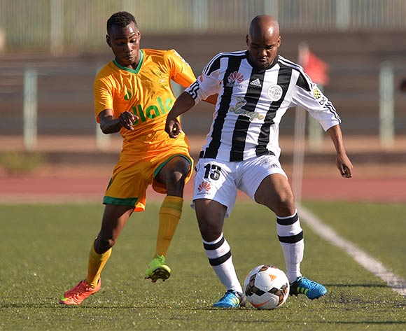 Kabo Ikaneng of Green Lovers Footballclub and Othusitse Pilane of Mochudi Centre Chiefs during the beMobile premiership match between Mochudi centre Chief and Green Lovers football Club at the Molepolole sports complex in Molepolole, Botswana on 17 October 2015. Monorail Bhuiyan/Backpage pix