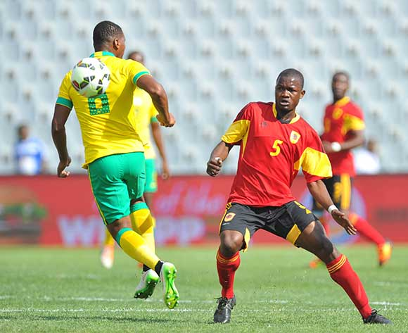 Mlungisi Mbunjana of South Africa challenged by Nelson Sumbo Fonseca of Angola during the CHAN 2016 Qualifiers match between South Africa and Angola at the Rand Stadium in Johannesburg, South Africa on October 17, 2015 ©Samuel Shivambu/BackpagePix