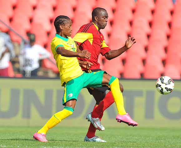 Levy Mokgothu of South Africa challenged by Mateus da Costa of Angola during the CHAN 2016 Qualifiers