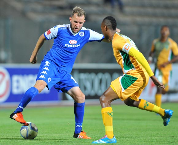 Jeremy Brockie of Supersport United challenged by Siyabonga Dube of Golden Arrows during the Absa Premiership match between Supersport United and Golden Arrows at the Lucas Moripe Stadium in Pretoria, South Africa on October 20, 2015 ©Samuel Shivambu/BackpagePix