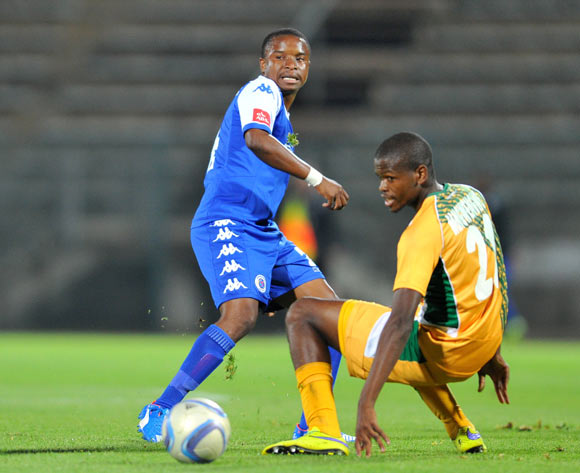 David Mathebula of Supersport United challenged by Nkanyiso Mngwengwe of Golden Arrows during the Absa Premiership match between Supersport United and Golden Arrows at the Lucas Moripe Stadium in Pretoria, South Africa on October 20, 2015 ©Samuel Shivambu/BackpagePix