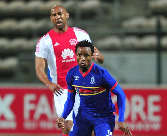 Partson Jaure of Tuks controls  the ball ahead of Nathan Paulse of Ajax Cape Town during the Absa Premiership 2015/16 game between Ajax Cape Town and University of Pretoria at Athlone Stadium, Cape Town on 21 October 2015 ©Ryan Wilkisky/Backpagepix