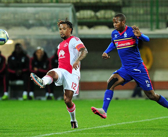 Granwald Scott of Ajax Cape Town gets his pass away under pressure from Thabo Mosadi of Tuks during the Absa Premiership 2015/16 game between Ajax Cape Town and University of Pretoria at Athlone Stadium, Cape Town on 21 October 2015 ©Ryan Wilkisky/Backpagepix