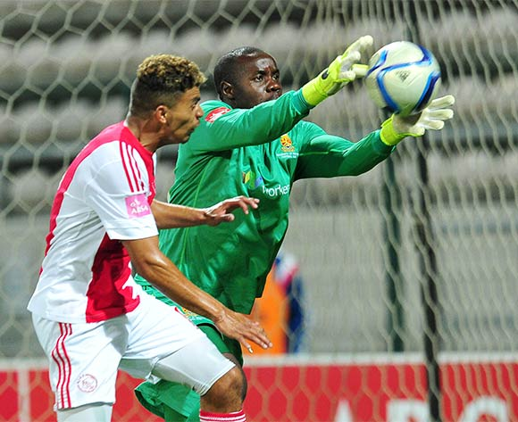 Washington Arubi of Tuks and Toriq Losper of Ajax Cape Town go for the ball during the Absa Premiership 2015/16 game between Ajax Cape Town and University of Pretoria at Athlone Stadium, Cape Town on 21 October 2015 ©Ryan Wilkisky/Backpagepix