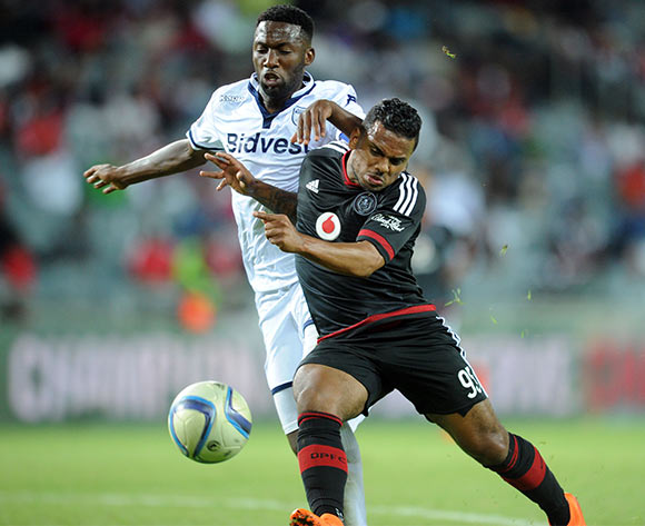 Kermit Erasmus of Orlando Pirates is challenged by Buhle Mkhwanazi of Bidvest Wits  during the Absa Premiership match between Orlando Pirates and Bidvest Wits  on 21 October 2015 at Orlando Stadium Pic Sydney Mahlangu/ BackpagePix